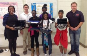 Price Band Director Tara Byrdsong, Big Note Music's Jim Schmeltzer,and The Gift of Music's Chris Monroe with the kids and their new instruments
