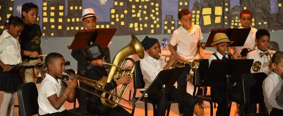 Students performing on musical instruments